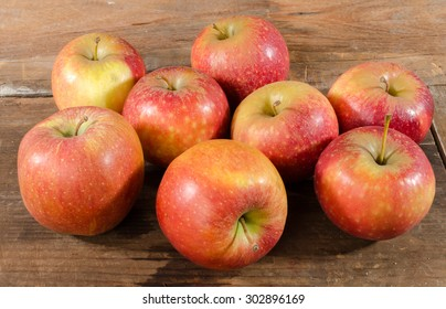 Tasty apples on wooden background