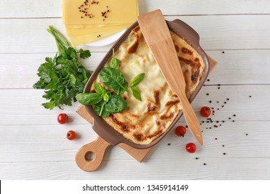 Tasty baked lasagna on white table