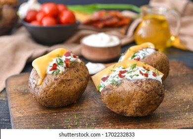 Tasty baked potato with sour cream on table