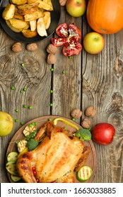 Tasty baked turkey and different food for Thanksgiving day on wooden table