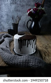 Tasty and beautiful chocolate cake on wooden background, dark photograpy styling