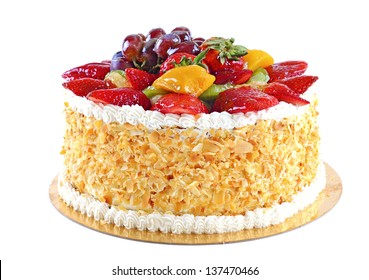 Tasty and beautiful decorated cake with fruits, isolated on white background