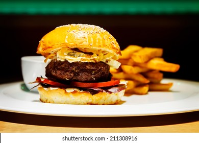 A tasty beef burger with blue cheese at the nice club restaurant.