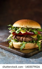 Tasty beef burger with vegetables on the table