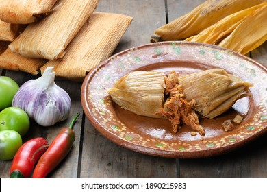 Tasty beef tamale on an artisan plate made of clay