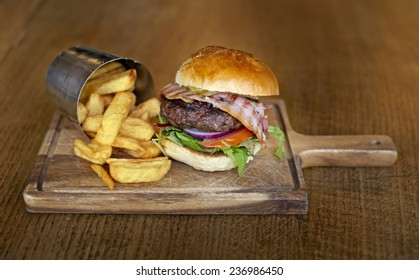 Tasty big burger with chips