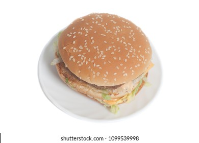 Tasty Big burger on plate isolated on a white background