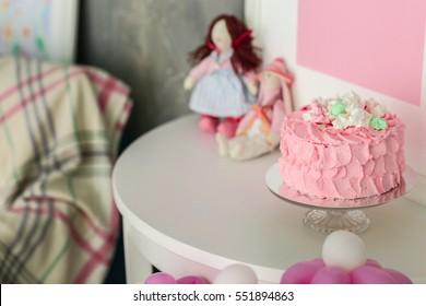 Tasty birthday cake on table in room