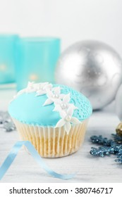 Tasty blue cupcake with decorations, closeup