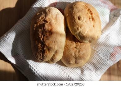 tasty bread on wooden table