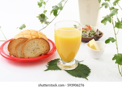 Tasty breads with a cup of juice