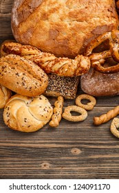 Tasty breads on wooden background