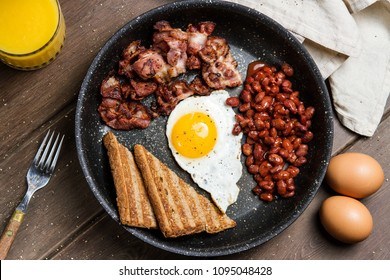 tasty breakfast with fried egg and bacon