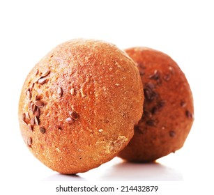 Tasty  brown buns with sesame isolated on white