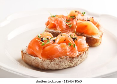 Tasty bruschetta with salmon
