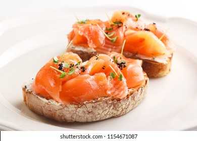 Tasty bruschetta with salmon