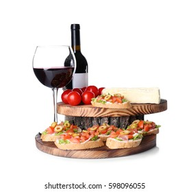 Tasty bruschetta served with wine on white background