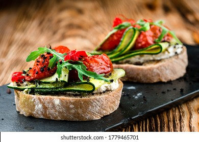Tasty bruschetta with tomato. Easy cook, nutritious snack. Beautifully decorated catering banquet menu. Food snacks and appetizers for buffet. bruschetta with tomato and cucumber - Shutterstock ID 1779465701