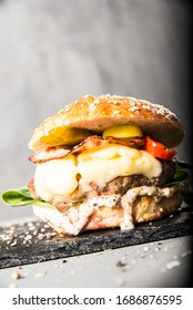 tasty burger on the modern concrete wall - Shutterstock ID 1686876595
