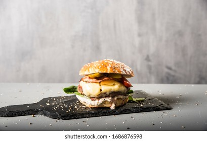 tasty burger on the modern concrete wall - Shutterstock ID 1686876598