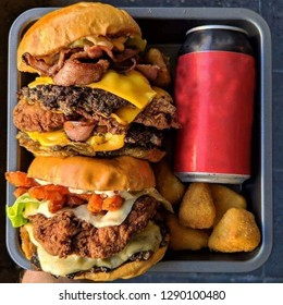 Tasty burger,Nuked and cans of soft drink isolated in tray.