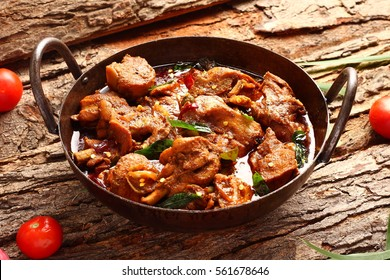 Tasty butter chicken curry dish form Indian cuisine in a cast iron cookware,