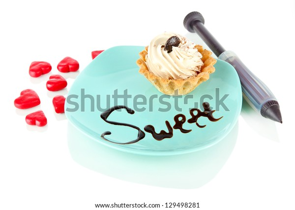 Tasty cake and chocolate inscription isolated on white