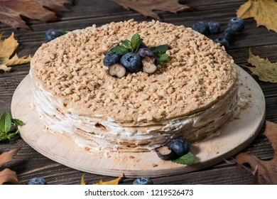 Tasty cake decorated with bluberries and autumn leafs