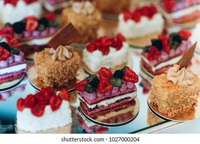 Tasty cake on wedding candybar with raspberry and blackberry
