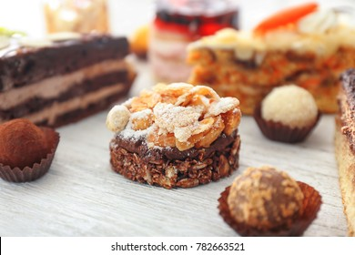 Tasty cake on white wooden background