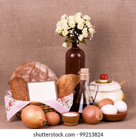 Tasty cakes and bread in basket, eggs, olive oil, eggs with banner add