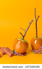 Tasty candy apples on color background
