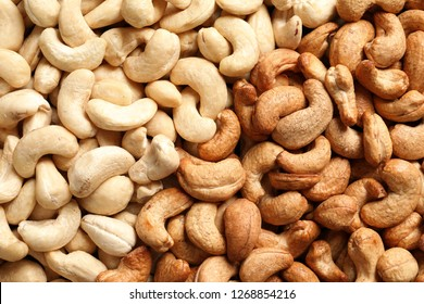 Tasty cashew nuts as background, top view