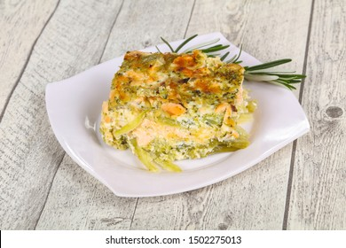 Tasty casserole with salmon and broccoli served rosemary