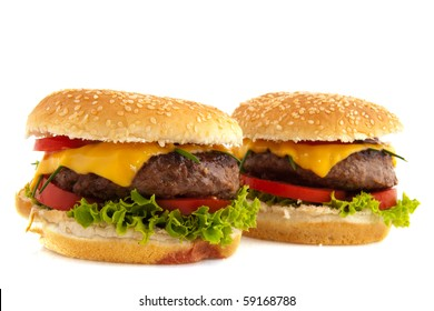 Tasty cheeseburgers with vegetables and bread roll