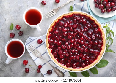 Tasty cherry pie on table