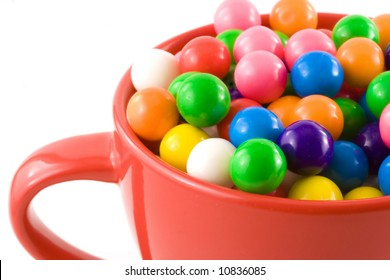 Tasty, chewy, sweet bubble gum balls rest inside a bright red cup.