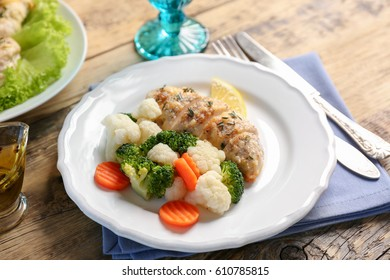 Tasty chicken breast with vegetables on plate