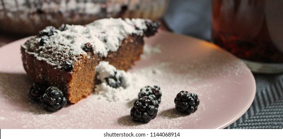 Tasty chocolate brownie cake with blackberry and suger powder