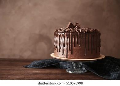 Tasty chocolate cake on table