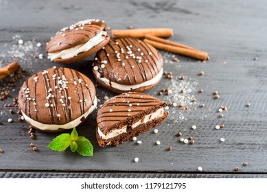 Tasty chocolate cookies on wooden background