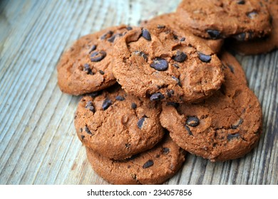 Tasty chocolate cookies on wooden table