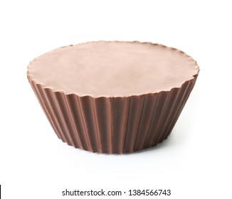 Tasty chocolate peanut butter cup on white background