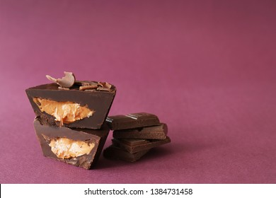 Tasty chocolate peanut butter cups on color background