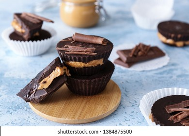 Tasty chocolate peanut butter cups on table