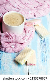 Tasty Christmas coffee or cocoa and sweet cookies on blue wooden background and pink tablecloth. Copy space