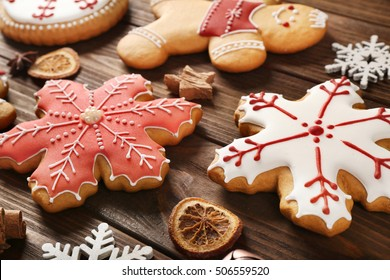 Tasty Christmas tasty cookies on wooden background