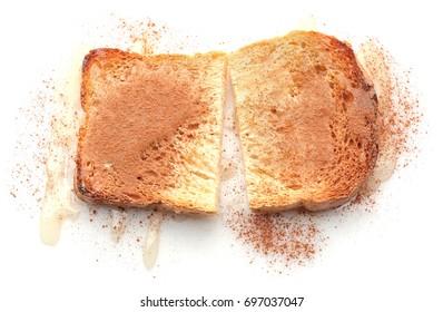 Tasty cinnamon toast on white background