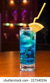 Tasty cocktail with blue curacao on bar counter