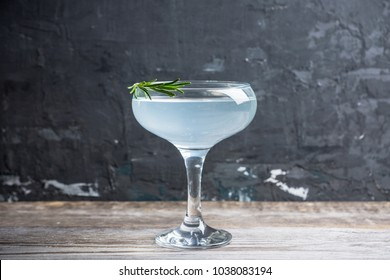 Tasty cocktail with rosemary. Shallow depth of field. Selective focus.